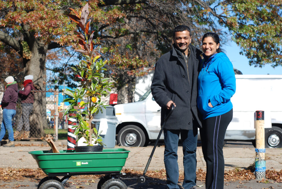 A happy couple takes home a tree at a TreePhilly giveaway event.